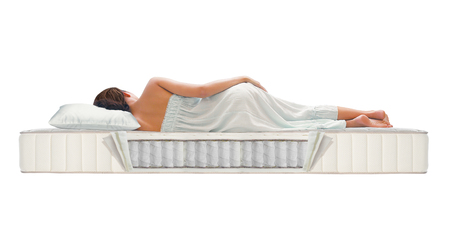 Photo pour Woman sleeping on pocket spring mattress - image libre de droit