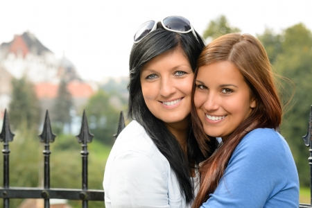 Mother and daughter spending free time outdoors teen family happy