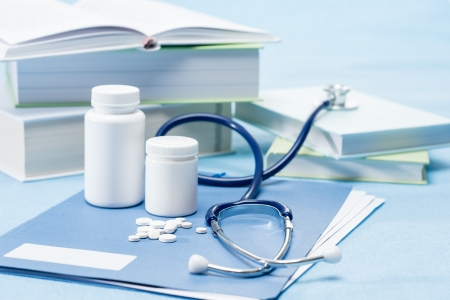 Photo for Doctor accessories and medications on blue background - Royalty Free Image