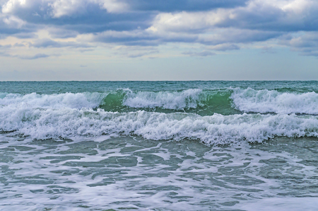 Foto de A strong wind rolls the waves to the shore on the Black sea. - Imagen libre de derechos