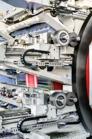 Foto per Detail of flexo drum press for label printing - flexography also called surface printing machine - Immagine Royalty Free