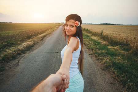 Photo pour Young woman leading man - image libre de droit