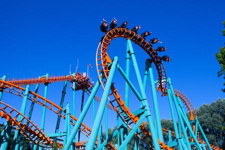 Foto de Orange rollercoaster with blue sky in the background - Imagen libre de derechos
