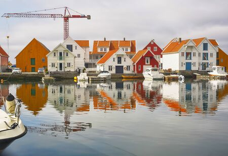 Foto de Skudeneshavn, Norway 07/19/2019  : Marina in the Norwegian town Skudeneshavn. Old Skudeneshavn is one of the most well kept old towns of Europe and a quiet harbour for tall ships and small boats alike. Narrow streets, the idyllic harbour and the old white - Imagen libre de derechos