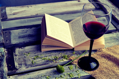 Photo for Open book with wine glass on a wooden background - Royalty Free Image