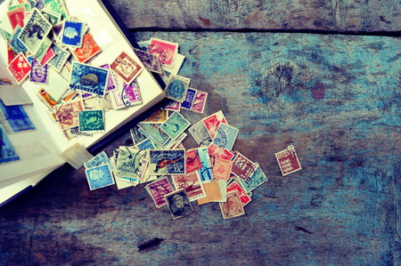 Foto de Old post stamps on a wooden background - Imagen libre de derechos