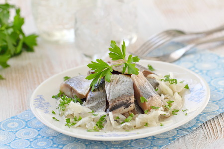 Photo for Delicious herring fillet with oil, marinated onion and fresh parsley - Royalty Free Image