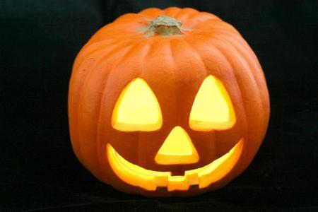 A glowing Halloween Jack-O-Lantern against a black background.