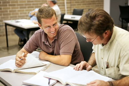 Adult education students studying together in class.