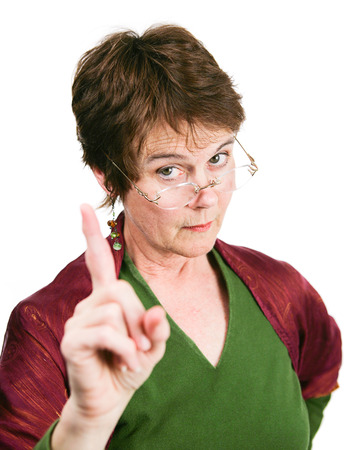 Photo pour Bossy looking middle-aged woman wagging her finger in disapproval.  Isolated on white.   - image libre de droit