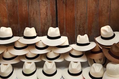 Foto de A selection of Panama hats piled up against a wooden door, Cartagena, Colombia. - Imagen libre de derechos