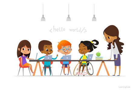 Photo pour Disabled girl in wheelchair and other children sitting at laptops and learning coding. - image libre de droit