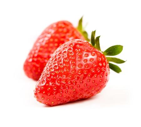 Foto de Macro shot of beautiful ripe and fesh strawberries isoltaed on white background. - Imagen libre de derechos