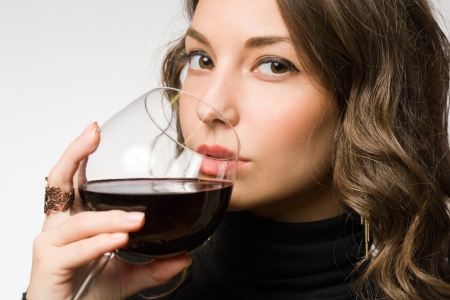 Portrait of a gorgeous young brunette woman enjoying premium wine