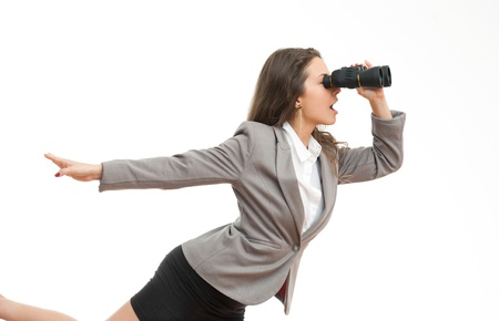 Photo for Portrait of a beautiful young brunette businesswoman with seeking with binoculars  - Royalty Free Image