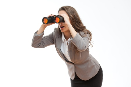 Photo for Portrait of fashionable young businesswoman searching the horizon with binoculars  - Royalty Free Image