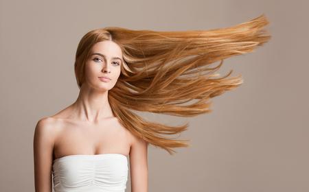 Foto de Portrait of a beautiful young blond woman with amazing flowing hair. - Imagen libre de derechos