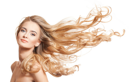 Foto de Portrait of a young blond woman with long healthy hair. - Imagen libre de derechos