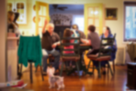 Photo pour Blur style of typical American family dinner in kitchen scene - image libre de droit