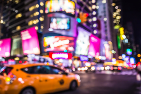 Photo pour Defocused blur of Times Square in New York City with lights at night and taxi cab - image libre de droit