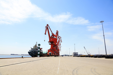 Photo for Portal crane and Cargo ship   - Royalty Free Image