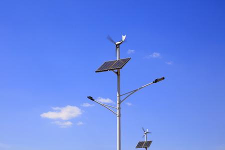 Foto de Solar wind street light under blue sky - Imagen libre de derechos