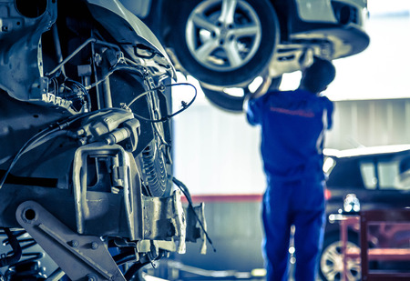 Foto de Auto repair factory parked engine,Workers concentrate on work. - Imagen libre de derechos