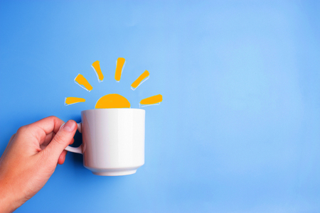 Photo for sun and white cup on blue background. good morning concept - Royalty Free Image