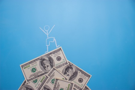 Photo for man standing on the dollars in a shape of a mountain. earn money concept - Royalty Free Image
