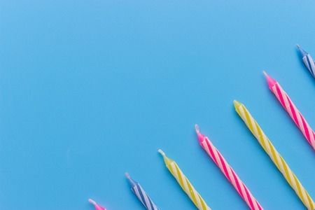 Photo for Birthday candles on blue background. close up - Royalty Free Image