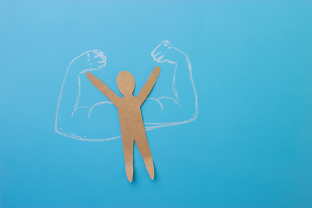Photo for paper man with muscles. self confidence concept - Royalty Free Image