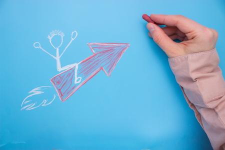 Photo pour Start-up - Business and Innovation Concept. character sit on the arrow - image libre de droit