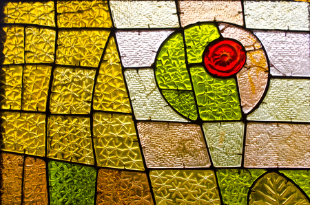 Foto de Rectangular and round stained glass window with red rose. Abstract geometric colorful background. Multicolored stained glass church window with irregular random block pattern. - Imagen libre de derechos