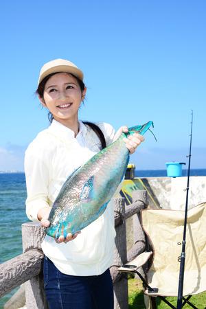 Woman with big fish
