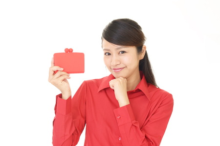 Photo for Smiling young woman with purse - Royalty Free Image