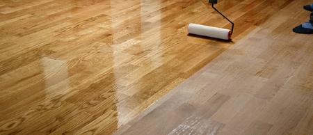 Foto de Lacquering wood floors. Worker uses a roller to coating floors. Varnishing lacquering parquet floor by paint roller - second layer. Home renovation parquet - Imagen libre de derechos