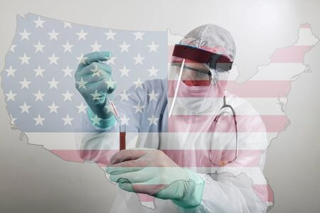 Foto de Doctor wearing respiratory mask and holding the Coronavirus Covid-19 blood sample. Scientists test for Covid-19 or Corona virus. Transparent flag of USA over the photo - Imagen libre de derechos