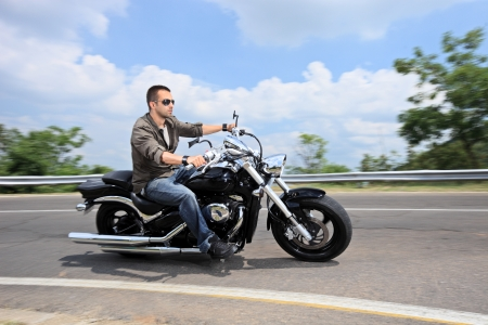 A young man riding a motorcycle