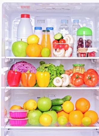 Foto de Shot of an open fridge with healthy food products - Imagen libre de derechos