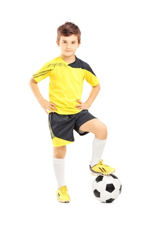 Photo for Full length portrait of a kid in sportswear posing with a soccer ball isolated on white background - Royalty Free Image