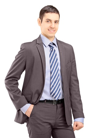 Foto de Young businessman wearing grey suit and looking at camera isolated on white background - Imagen libre de derechos