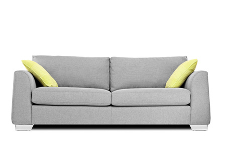 Foto de Studio shot of a modern couch with pillows isolated on white  - Imagen libre de derechos