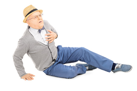 Foto de Middle aged gentleman laying on the ground having a heart attack isolated on white background - Imagen libre de derechos
