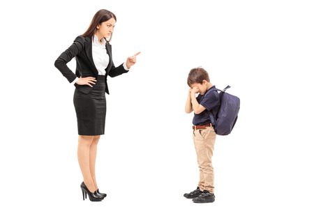 Foto de Angry mother disciplining her son isolated on white background - Imagen libre de derechos