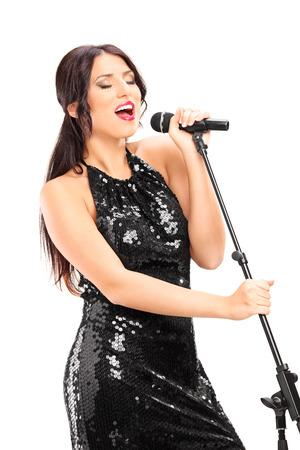 Photo for Elegant female singer singing on microphone isolated on white background - Royalty Free Image