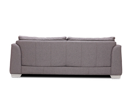 Photo pour Rear view studio shot of a modern gray sofa isolated on white background - image libre de droit