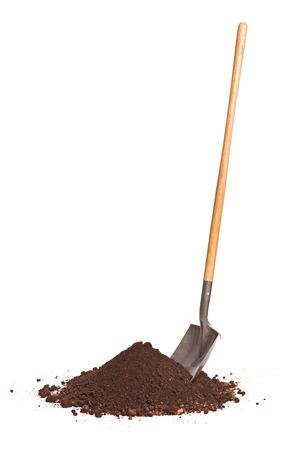 Foto de Vertical studio shot of a shovel stuck in a pile of dirt isolated on white background - Imagen libre de derechos