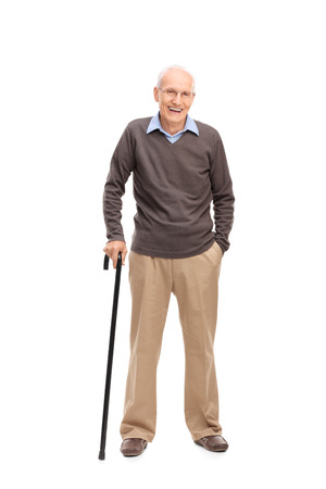 Foto de Full length portrait of a senior man with a cane smiling and posing isolated on white background - Imagen libre de derechos