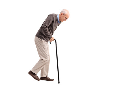 Photo pour Studio shot of an exhausted old man walking with a cane isolated on white background - image libre de droit