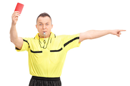 Photo pour Angry football referee showing a red card and pointing with his hand isolated on white background - image libre de droit